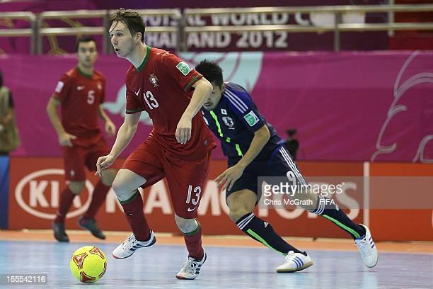 Marinho of Portugal gets past Shota Hoshi of Japan during the FIFA Futsal  World Cup Group 80223fd07fef3