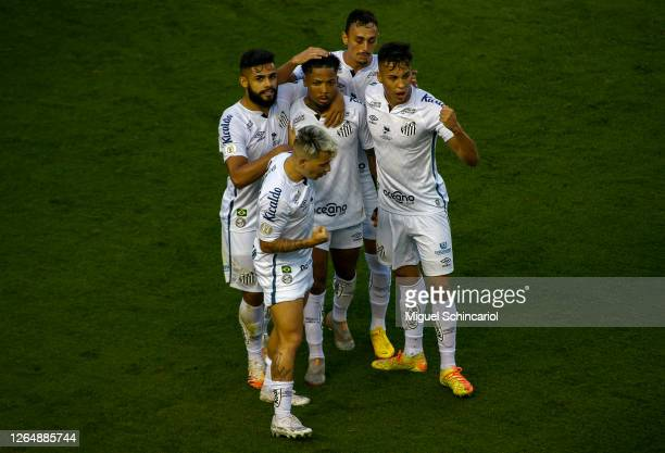 Marinho of Santos celebrates with teammates after scoring his team's first goal during a match between Santos and Red Bull Bragantino as part of...