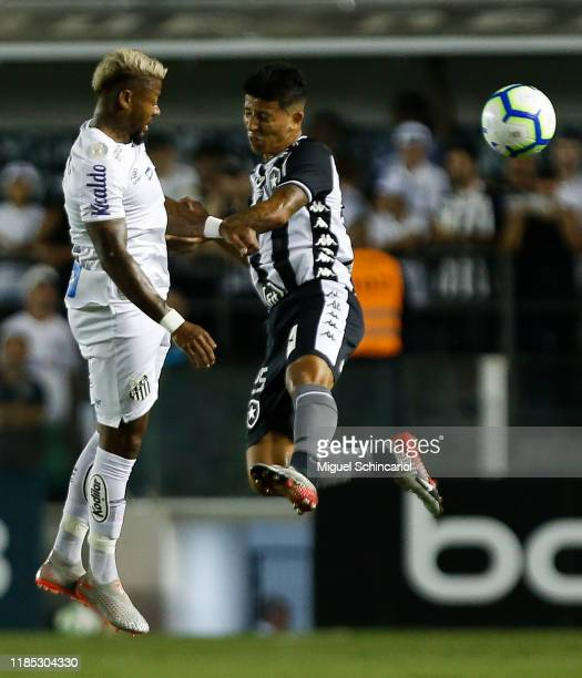 Marinho of Santos jumps for the ball with Wenderson of Botafogo during a match between Santos and Botafogo for the Brasileirao Series A 2019 at Vila...