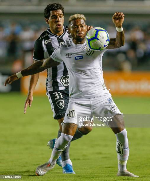 Marinho of Santos vies for the ball with Yuri of Botafogo during a match between Santos and Botafogo for the Brasileirao Series A 2019 at Vila...