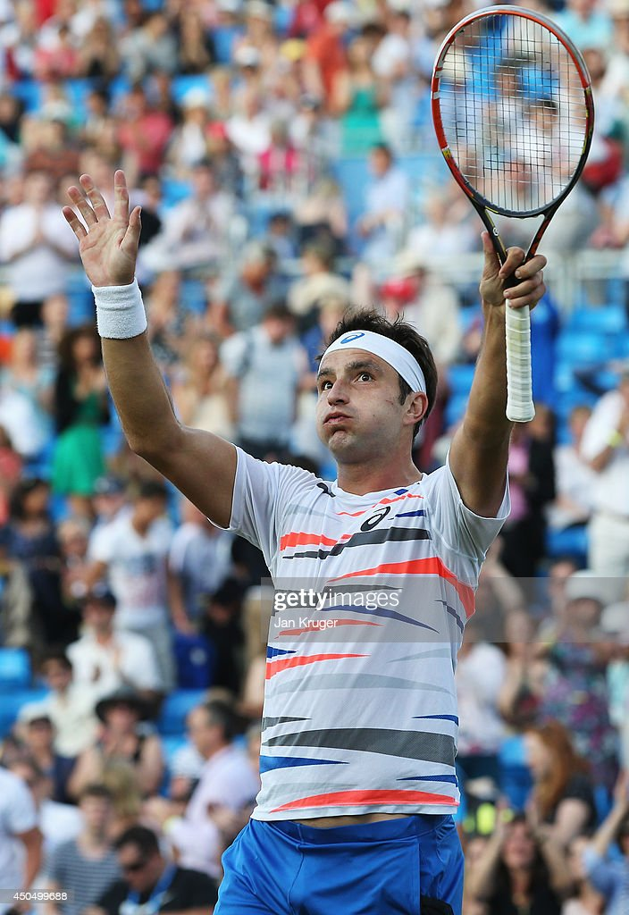 Marinko Matosevic of Australia celebrates after defeating Jo-Wilfried Tsonga of France during their Men's Singles match on day four of the Aegon Championships at Queens Club on June 12, 2014 in London, England.