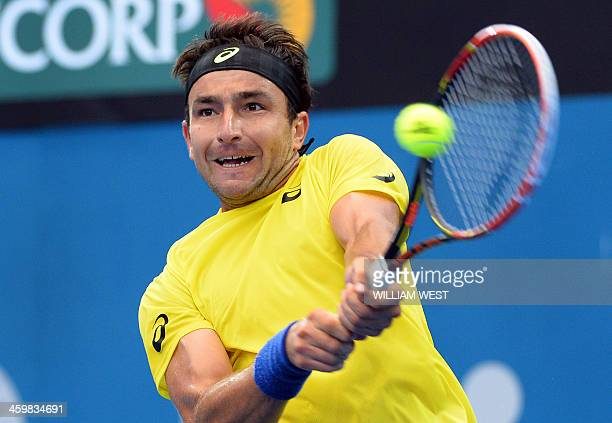 Marinko Matosevic of Australia hits a backhand return during his match against Sam Querry of the US at the Brisbane International tennis tournament...
