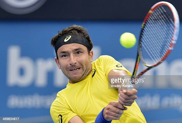Marinko Matosevic of Australia plays a backhand in his match against Sam Querrey of the USA during day four of the 2014 Brisbane International at...
