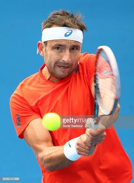 Marinko Matosevic of Australia plays a backhand in his match against Alejandro Gonzalez of Colombia during round two of 2016 Australian Open...
