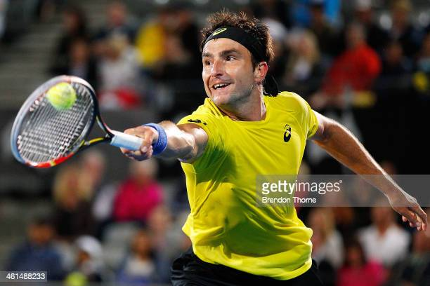 Marinko Matosevic of Australia plays a backhand in his quarter final match against Sergiy Stakhovsky of the Ukraine during day five of the 2014...