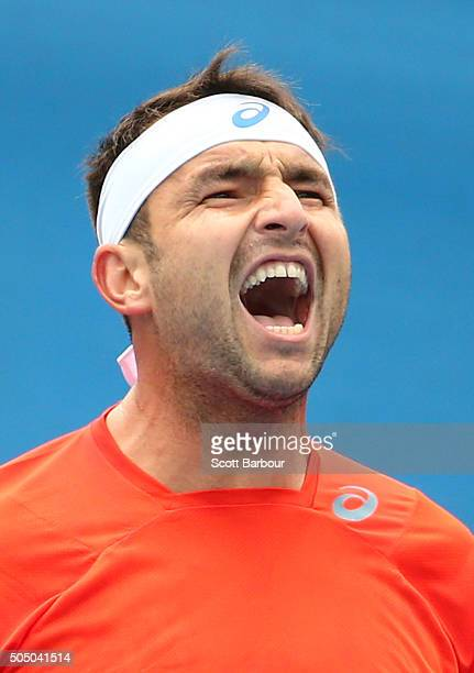 Marinko Matosevic of Australia reacts in his match against Alejandro Gonzalez of Colombia during round two of 2016 Australian Open Qualifying at...