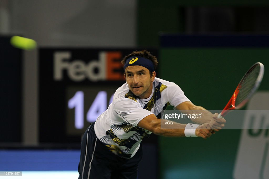 Marinko Matosevic of Australia returns a ball to Milos Raonic of Canada during day three of the Shanghai Rolex Masters at the Qi Zhong Tennis Center on October 9, 2012 in Shanghai, China.