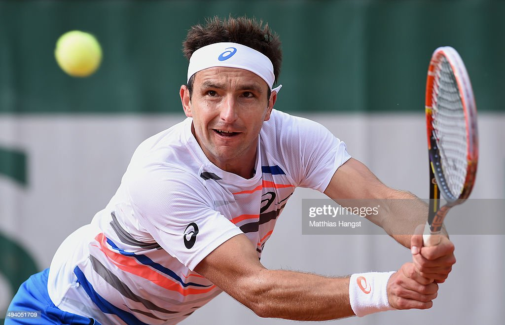 Marinko Matosevic of Australia returns a shot during his men's singles match against Dustin Brown of Germany on day three of the French Open at Roland Garros on May 27, 2014 in Paris, France.