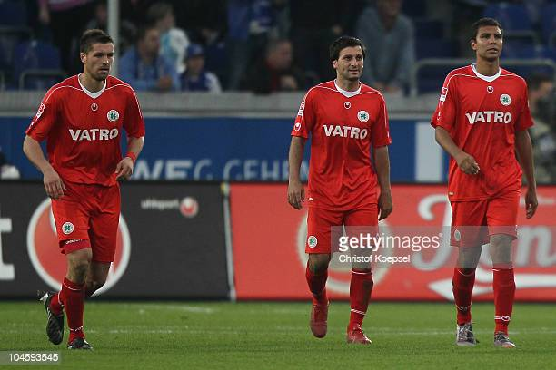 Marinko Miletic Markus Kaya and Daniel Gordon of Oberhausen look dejected after the second goal of Duisburg during the Second Bundesliga match...