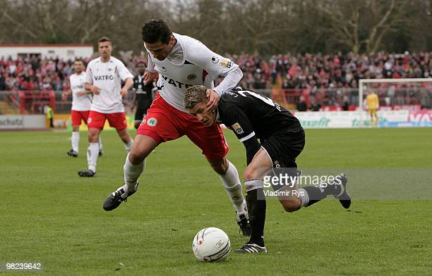 Marinko Miletic of Oberhausen defends Ivo Ilicevic of Kaiserslautern during the Second Bundesliga match between RotWeiss Oberhausen and 1 FC...