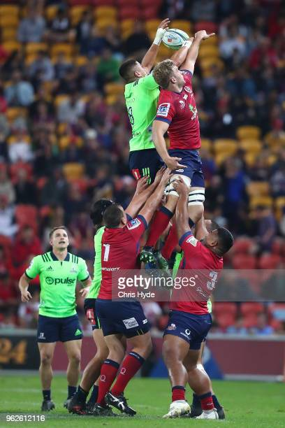 Marino Mikaele Tu'u of the Highlanders and Angus ScottYoung of the Reds compete for the ball during the round 15 Super Rugby match between the Reds...