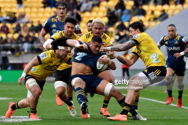 Marino Mikaele Tu'u of the Highlanders Is tackled during the round 5 Super Rugby Aotearoa match between the Hurricanes and the Highlanders at Sky...