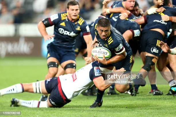 Marino Mikaele-Tu'u of the Highlanders is tackled during the round five Super Rugby match between the Highlanders and the Rebels at Forsyth Barr...