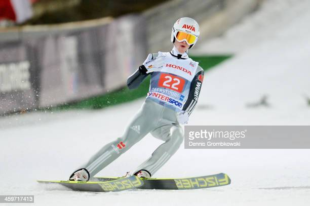 Marinus Kraus of Germany reacts after the final round on day 2 of the Four Hills Tournament Ski Jumping event at SchattenbergSchanze on December 29...