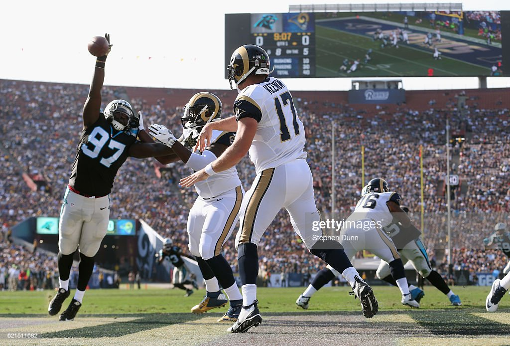 Mario Addison #97 of the Carolina Panthers blocks a pass by quarterback Case Keenum #17 of the Los Angeles Rams in the endzone during the first quarter of the game at the Los Angeles Coliseum on November 6, 2016 in Los Angeles, California.