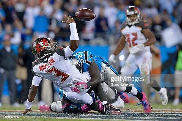 Mario Addison of the Carolina Panthers forces a fumble as he hits Jameis Winston of the Tampa Bay Buccaneers during the game at Bank of America...