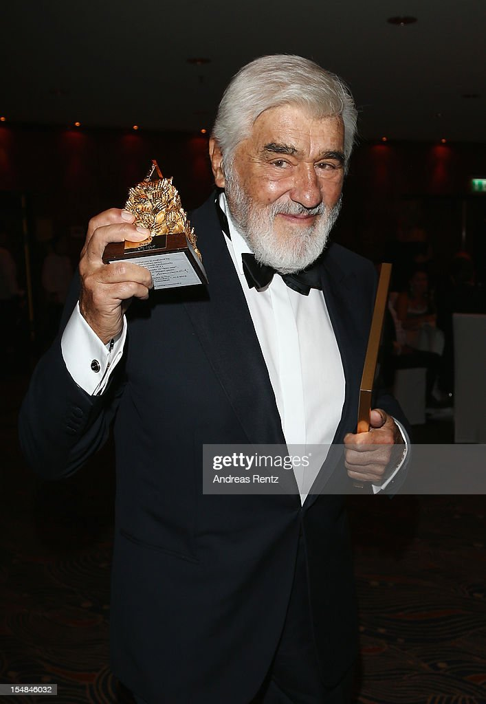 Mario Adorf holds up his award during the 21st UNESCO Charity Gala 2012 on October 27, 2012 in Dusseldorf, Germany.