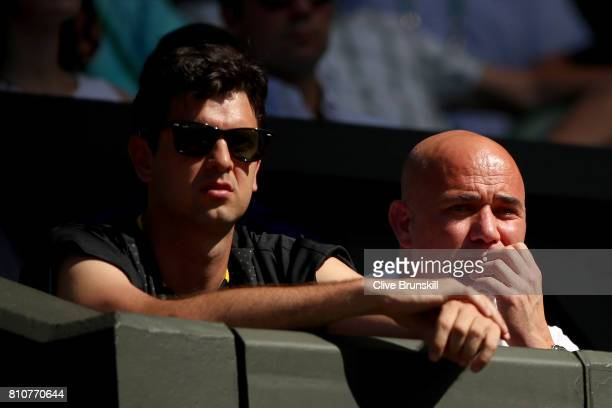 Mario Ancic ex proffesional tennis player and Andre Agassi coach of Novak Djokovic of Serbia look on during the Gentlemen's Singles third round match...