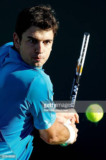 Mario Ancic of Croatia returns a shot to Bobby Reynolds Jeremy Chardy of Italy during the BNP Paribas Open on March 11 2010 in Indian Wells California