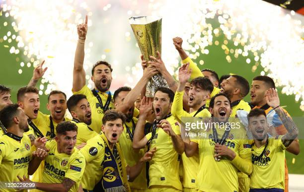 Mario and Raul Albiol of Villarreal CF lift the UEFA Europa League Trophy as their team mates celebrate following victory in the UEFA Europa League...