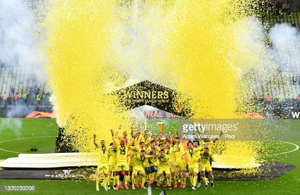 Mario and Raul Albiol of Villarreal CF lift the UEFA Europa League Trophy as their team mates celebrate following victory during the UEFA Europa...