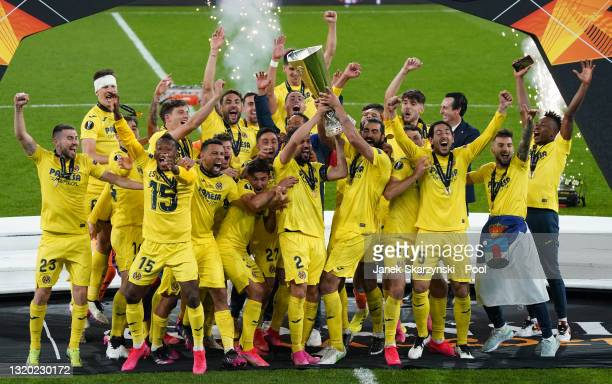 Mario and Raul Albiol of Villarreal lift the UEFA Europa League Trophy following victory in the UEFA Europa League Final between Villarreal CF and...