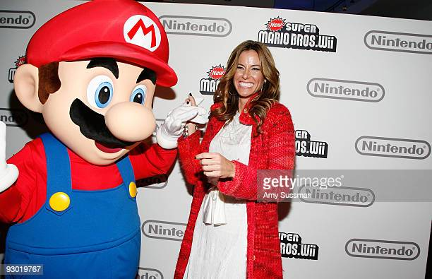 Mario and ''Real Housewives'' star Kelly Bensimon attends the 25 years of Mario celebration at the Nintendo World Store on November 12 2009 in New...