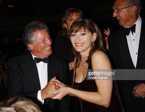 Mario Andretti and CNBC anchor woman Maria Bartiromo attend a pre-dinner Gala for the Columbus Day Parade October 9, 2004 in New York City.