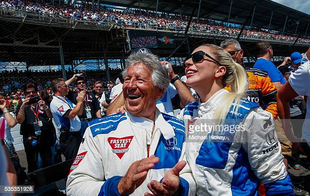 Mario Andretti and Lady Gaga are seen before the the start of the Indy 500 at the Indianapolis Motor Speedway on May 29 2016 in Indianapolis Indiana