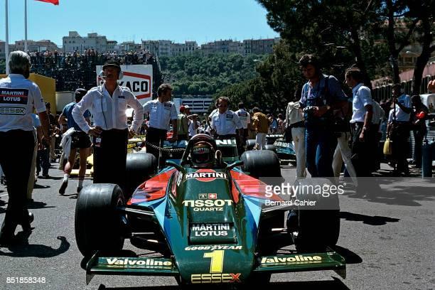 Mario Andretti Colin Chapman LotusFord 80 Grand Prix of Monaco Circuit de Monaco 27 May 1979 Lotus owner Colin Chapman watches as Mario Andretti sits...