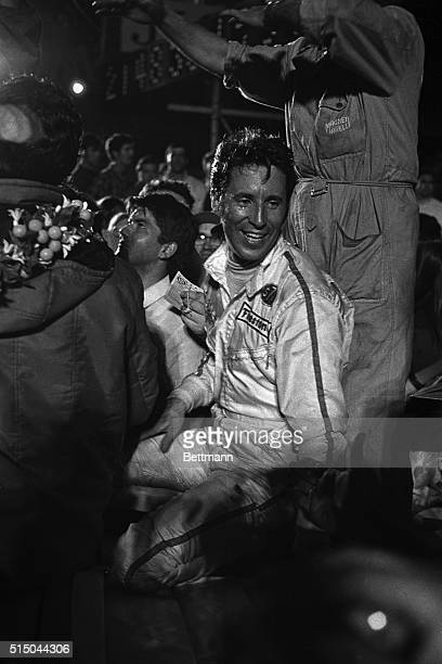 Mario Andretti gives the victory sign March 21st after winning the Sebring 12-Hour Grand Prix in a 512S Ferrari. Andretti and his partner led all day...