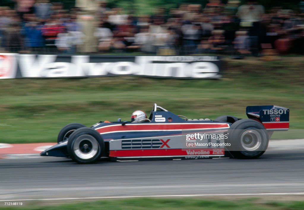 Mario Andretti of the United States in action, driving a #11 Alfa Romeo 179C with a Lotus 81 with a Ford V8 engine for Team Essex Lotus, at the British Grand Prix in Brands Hatch on 13th July 1980. Andretti would go on to retire from the race during the 57th lap due to gearbox problems.