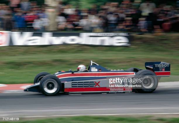 Mario Andretti of the United States in action driving a Alfa Romeo 179C with a Lotus 81 with a Ford V8 engine for Team Essex Lotus at the British...