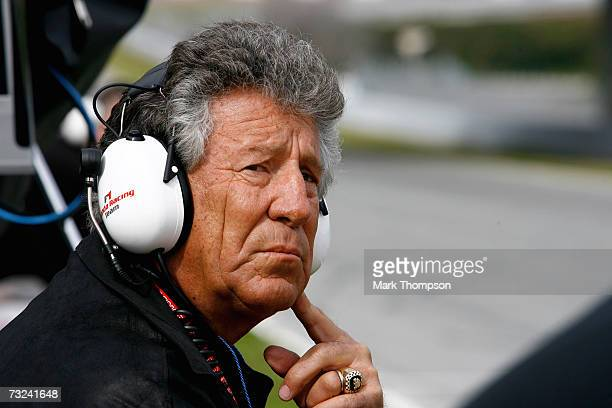 Mario Andretti of the USA looks on as his grandson Marco Andretti tests for Honda during Formula One testing at the Circuit De Jerez on February 7...