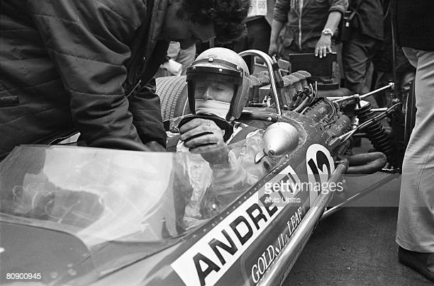 Mario Andretti on pole in his first Grand Prix sits in the Lotus-Ford Type 49B Formula One car moments to start of the United States Grand Prix held...