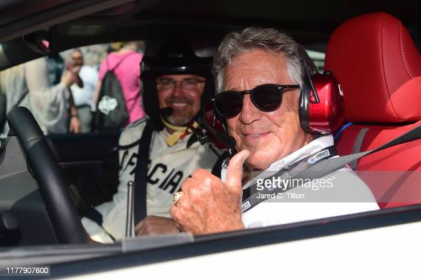 Mario Andretti poses for a photo opportunity prior to leading the field to the green flag for the Monster Energy NASCAR Cup Series Bank of America...