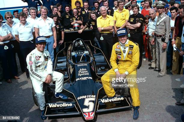 Mario Andretti Ronnie Peterson Colin Chapman LotusFord 79 Grand Prix of Italy Monza 10 September 1978 Happy photo of Team Lotus taken on the morning...