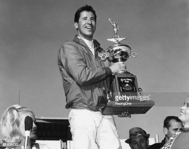 Mario Andretti stands in victory lane after winning the Daytona 500 on February 26 1967 at the Daytona International Speedway in Daytona Beach Florida