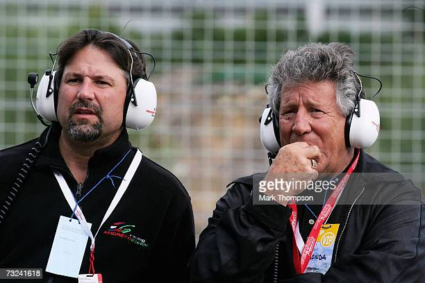 Mario Andretti, with his son Michael Andretti of the USA, look on as Marco Andretti, the son Michael, tests for Honda during Formula One testing at...