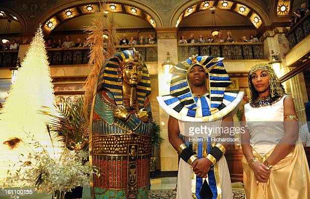 Mario Avent middle and Hiwat Gebremariam dressed up as ancient egyptians as part of the decorations for the event The 23rd Champagne Cascade held...