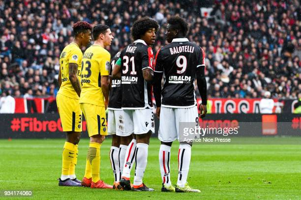 Mario Balotelli and Dante of Nice during the Ligue 1 match between OGC Nice and Paris Saint Germain at Allianz Riviera on March 18 2018 in Nice