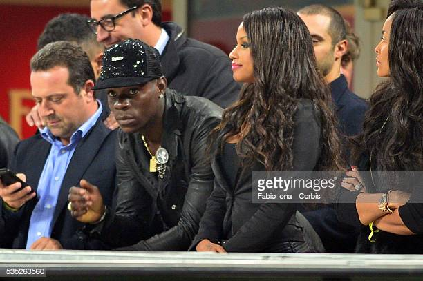 Mario Balotelli and Fanny look on before the Serie A match between AC Milan and Udinese Calcio at Giuseppe Meazza Stadium on October 19 2013 in Milan...