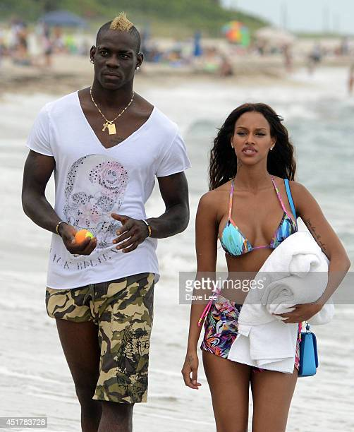 Mario Balotelli and Fanny Neguesha are seen on the beach in Miami Beach on July 6 2014 in Miami Florida
