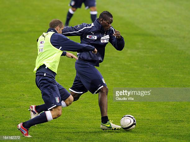 Mario Balotelli and Giorgio Chiellini of Italy attend a training session ahead of their FIFA World Cup Brazil 2014 qualifier against Danimarca at...