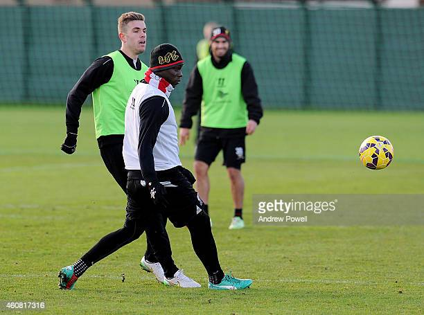 Mario Balotelli and Jordan Henderson of Liverpool during a training session at Melwood Training Ground on December 24 2014 in Liverpool England