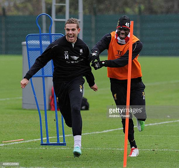 Mario Balotelli and Jordan Henderson of Liverpool laughing during a training session at Melwood Training Ground on November 6 2014 in Liverpool...