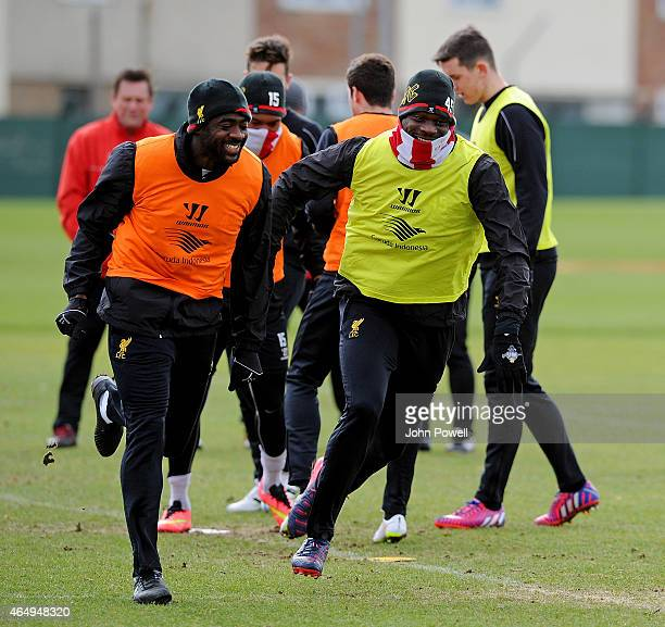 Mario Balotelli and Kolo Toure of Liverpool during a training session at Melwood Training Ground on March 2 2015 in Liverpool England