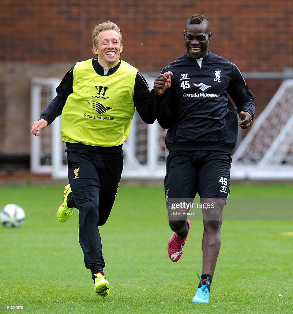 Mario Balotelli (R) and Lucas Leiva of Liverpool share a joke during a training session at at Melwood Training Ground on August 29, 2014 in Liverpool, England.