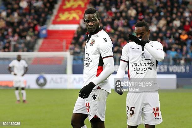 Mario Balotelli and Wylan Cyprien of Nice during the Ligue 1 match between SM Caen and OGC Nice at Stade Michel D'Ornano on November 6, 2016 in Caen,...