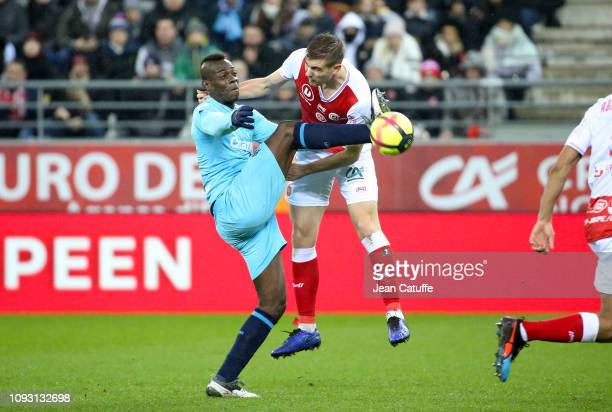 Mario Balotelli, Bjorn Engels of Reims during the french Ligue 1 match between Stade de Reims and Olympique de Marseille at Stade Auguste Delaune on...